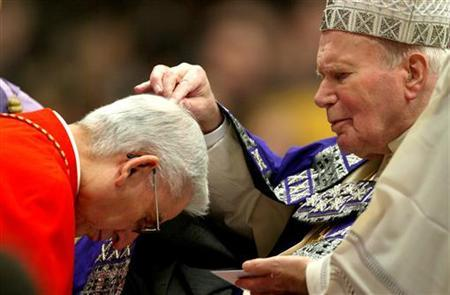 POPE JOHN PAUL II SPREADS ASH ON CARDINAL CASTRILLON HOYOS DURING THE ASH WEDNESDAY AT THE VATICAN.