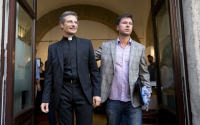 Mgr Krzysztof Charamsa and his partner Eduard, surname not given, pose for a photo as they leave a restaurant after a press conference in Rome (AP)