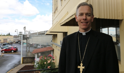 Portland, Ore., archbishop stands outside penitentiary where he confirmed four death-row prisoners in private ceremony