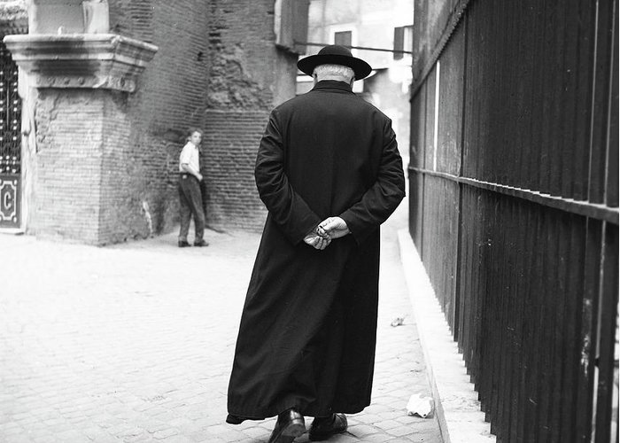 a-priest-walks-down-a-street-in-rome-1955-the-harrington-collection.jpg